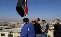 علم نظام الأسد يرفرف فوق مناطق سيطرة المليشيات الكردية في حلب