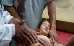 أطفال حي الوعر محاصَرون بالمرض والرصاص