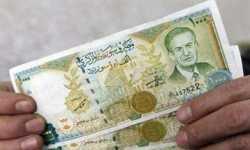 الليرة السورية تواصل انهيارها.. الدولار أصبح قريباً من عتبة الـ (1000)