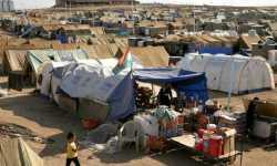 لاجئون يستبدلون الطعام بملابس تقيهم البرد