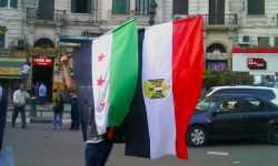 علم النظام يرفرف بقصر النيل: هل أعاد السيسي الشرعية للأسد؟