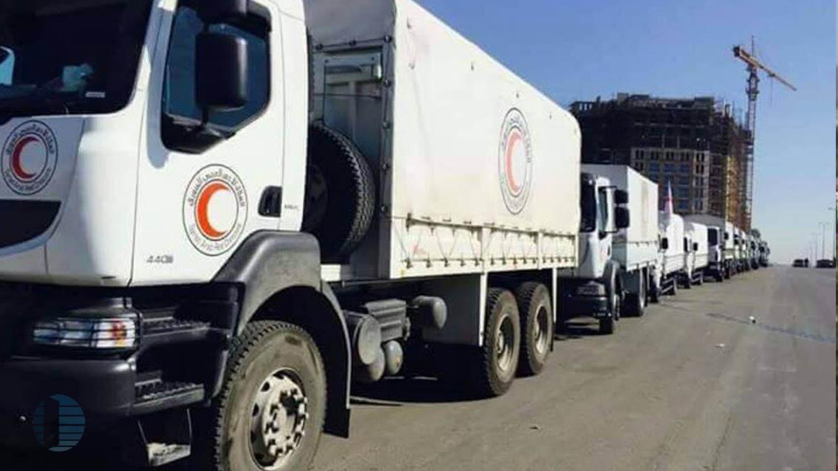 النظام يحرم حي الوعر من قافلة مساعدات إنسانية، وميلشياته الشيعية تسطو عليها