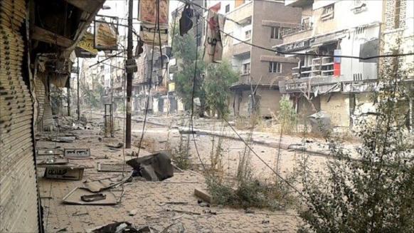 المعارك والحصار يلاحقان سكان مخيم اليرموك